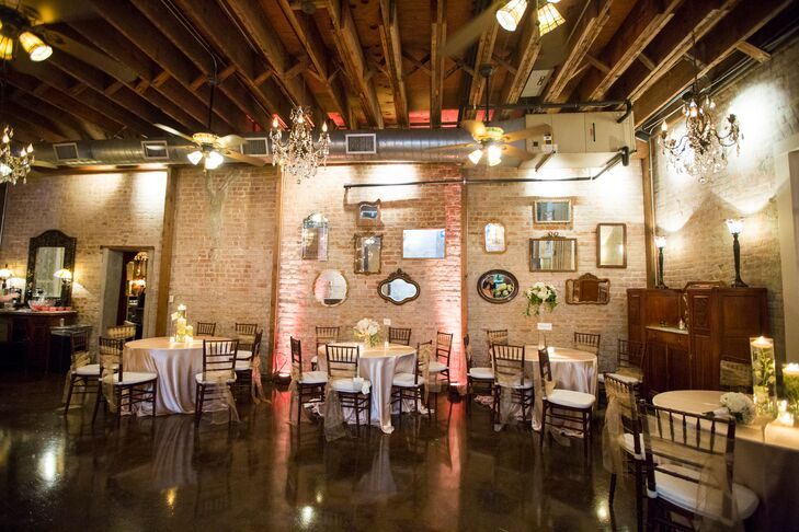 Butler's Courtyard in League City, Texas, had the perfect vintage vibe for Alexandra and Thomas's classic, romantic wedding. The mirrors on the wall paired with candles and  gentle lighting added to the ambience.