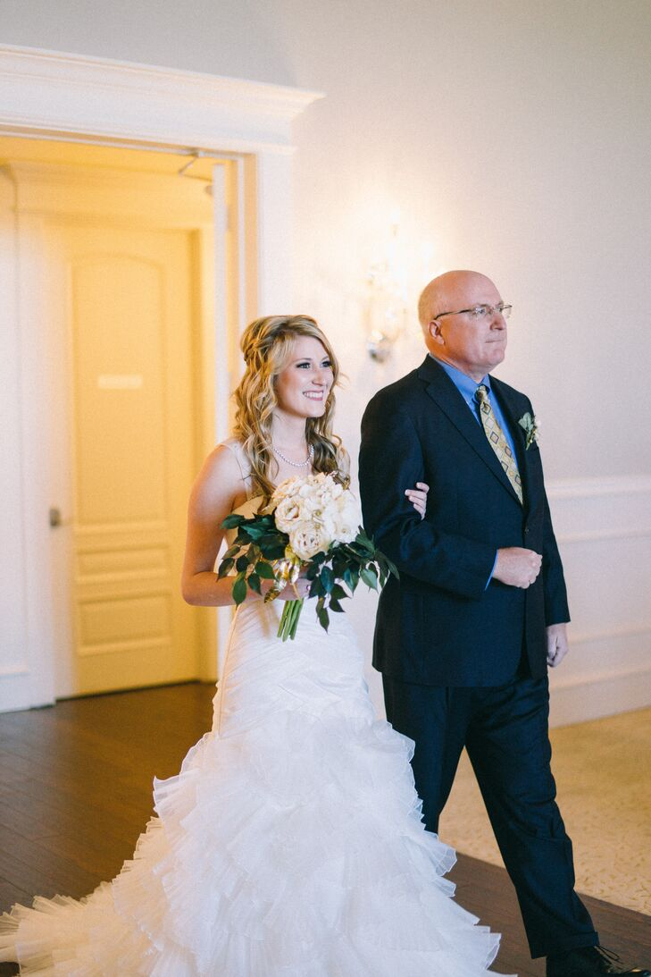Elena and her father walked arm in arm down the aisle. She clutched a DIY bouquet of faux ivory roses and eucalyptus leaves.