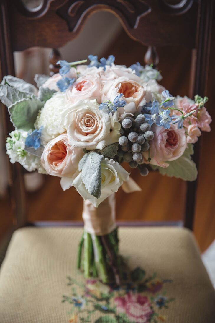 Erika carried roses, lamb's ear and silver brunia balls in her lush blush, ivory and blue bouquet.