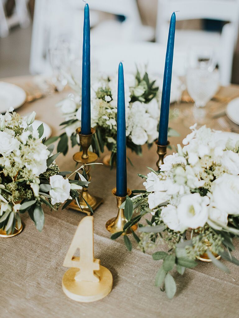 Rustic centerpiece idea with small arrangements and blue taper candles