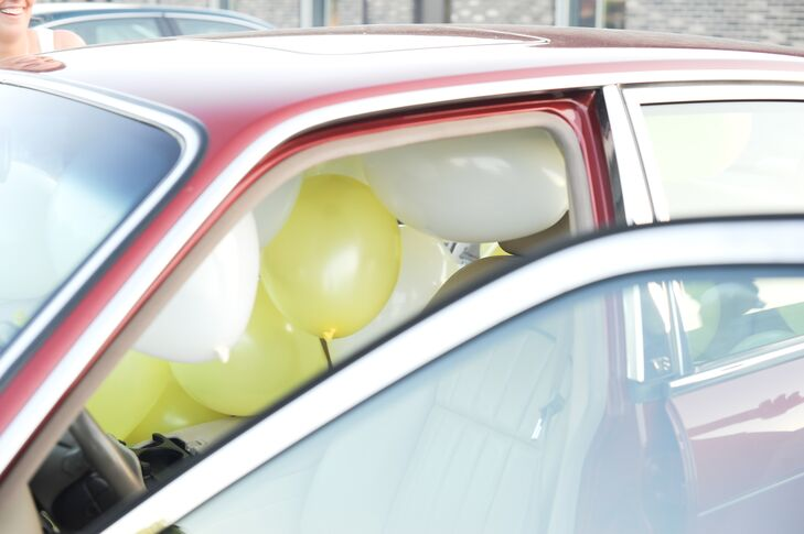White and yellow balloons filled the inside of the couple's getaway car.