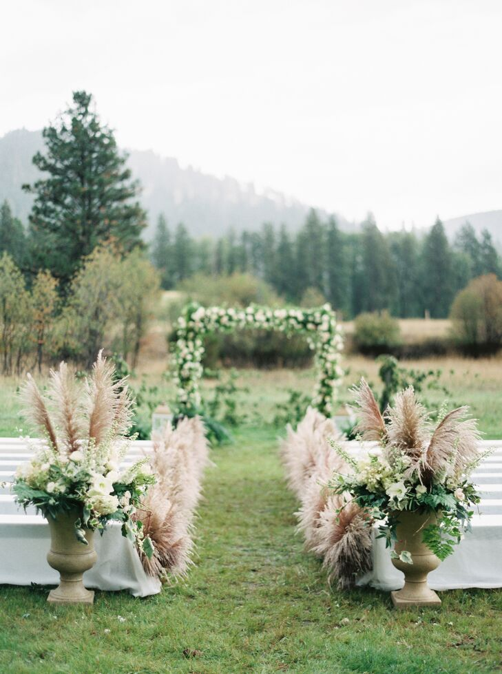 One unique element of the ceremony decor was the tall wheat-colored pampas grass lining the aisle. The wedding planner had the grass flown in for the wedding. The tufted grass looked almost like ostrich feathers, creating a romantic, stylish, bohemian aesthetic.