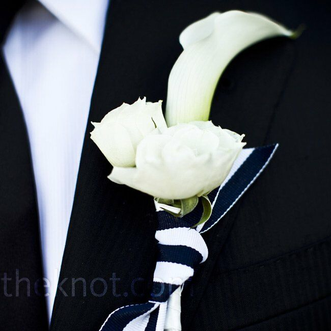 To match Adrienne's bouquet, Justin wore a white mini calla lily and spray rose boutonniere tied with the same striped ribbon.