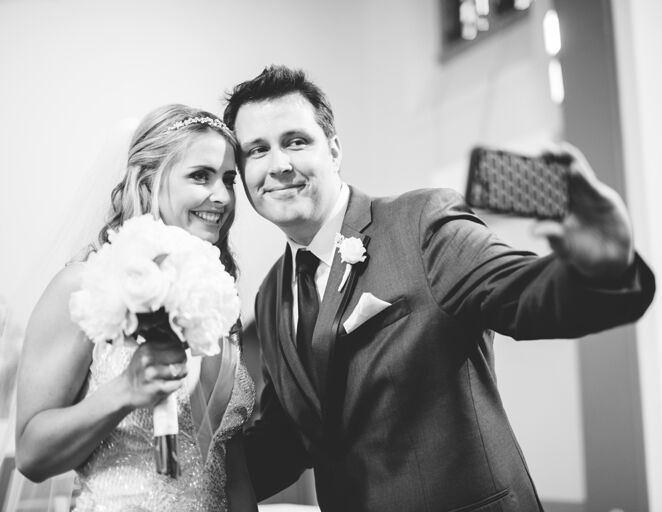 Bride and groom wedding selfie