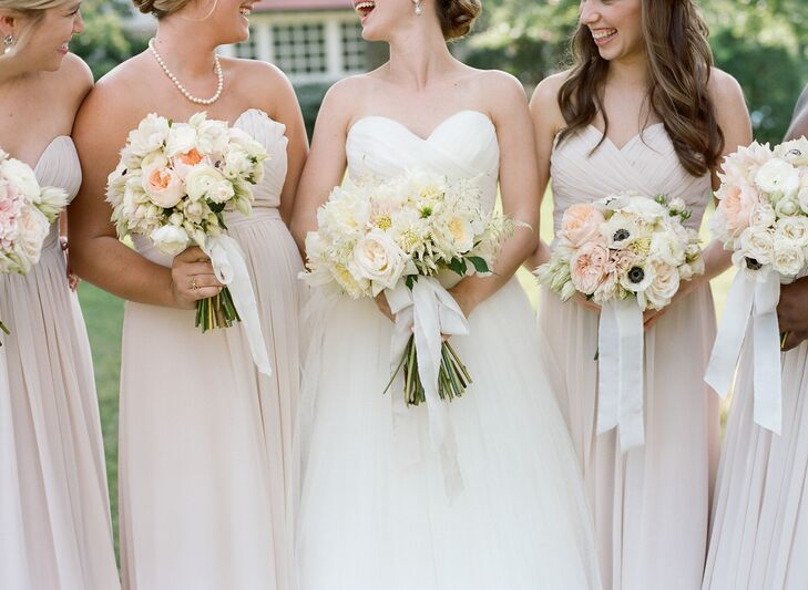 The bridesmaids carried different versions of anemones, garden roses, ranunculus and scabiosa in their blush and ivory bouquets.