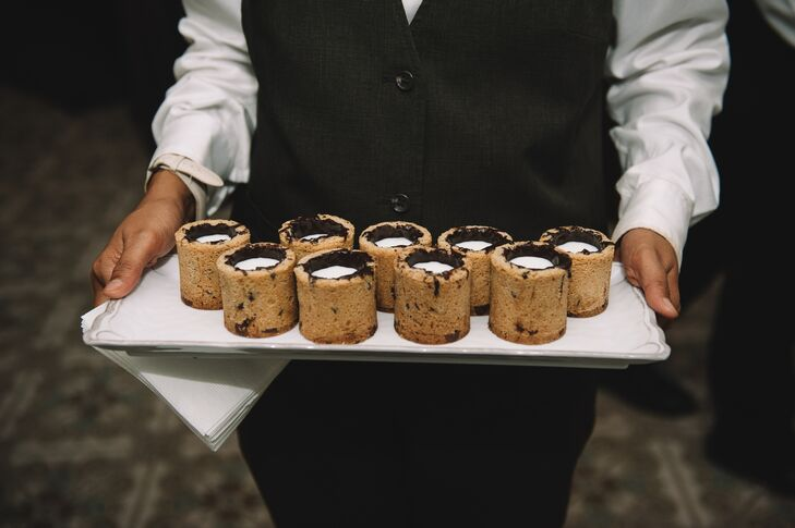 "Instead of a wedding cake, Molly and Michael served Dippin' Dots and cookie shot glasses filled with milk. ""They were a huge hit,"" Molly says."