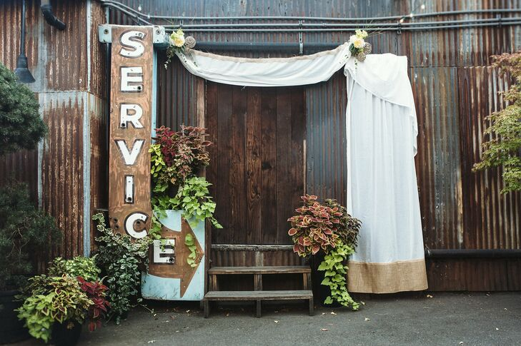 The couple was married in the outside courtyard of the Georgetown Ballroom, in front of the site's vintage Service sign and an arrangements of beautiful greenery. Plain white curtains added an elegant touch to the decor.