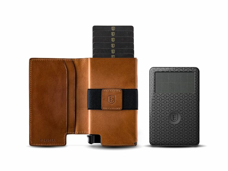 Brown Ekster wallet with ejecting card section and gray tracker card
