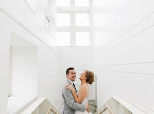 Samantha Gettel (28 and a supply planner) and Jonathan Klobucar's (29 and a lead software developer) art deco–inspired accents, snow-white blooms and