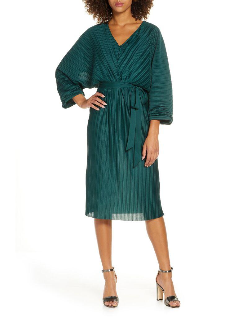 Green pleated winter wedding guest dress