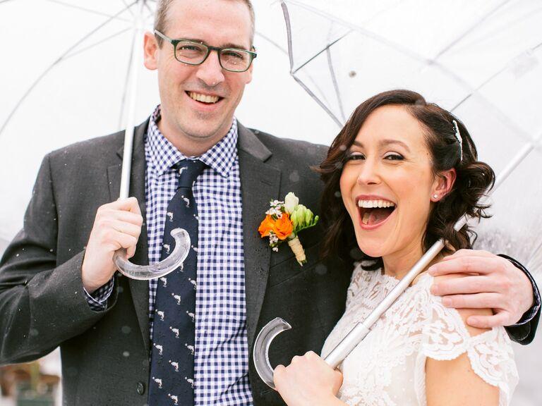 Rainy wedding with umbrellas