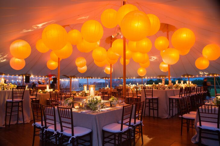 Japanese lanterns covered the ceiling of the tent while hundreds of white candles filled the rest of the space with a soft glow.