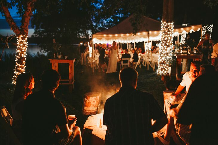 Trees wrapped in twinkle lights, a large bonfire and string lights in the outdoor tent gave the reception a magical glow.