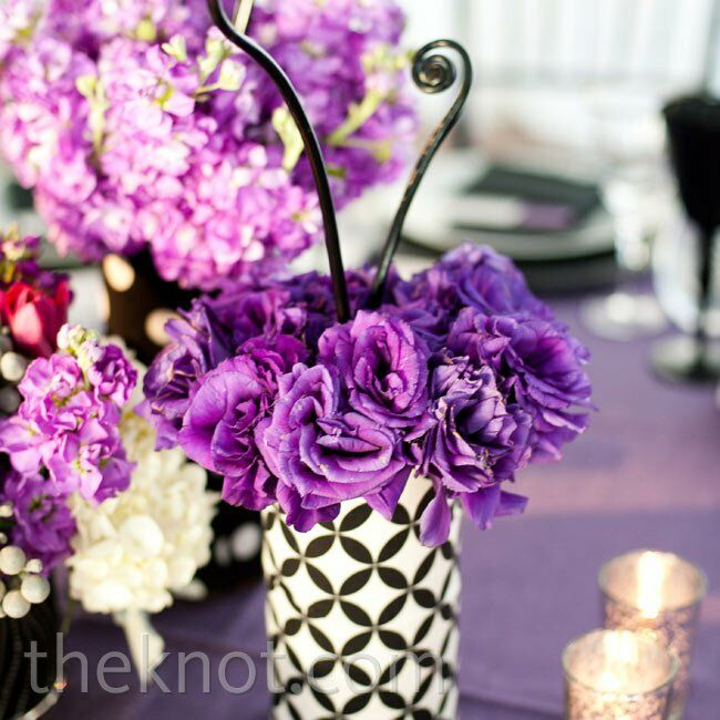 Graphic vases and bold color made a striking statement, even in low arrangements (which alternated with tall ones).