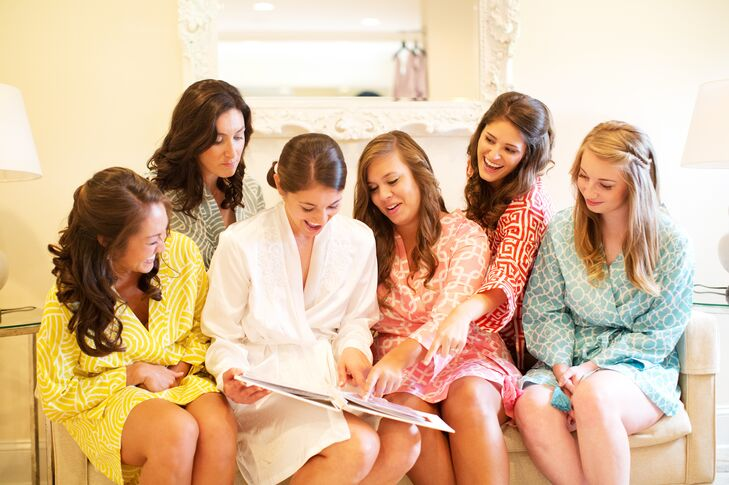Bernadette's bridesmaids created a memory book that they presented to her the day of the wedding. Her girlfriends filled it with photographs from their childhood, college and her bachelorette weekend together, along with personal messages.