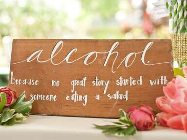 DIY painted quote sign for wedding bar