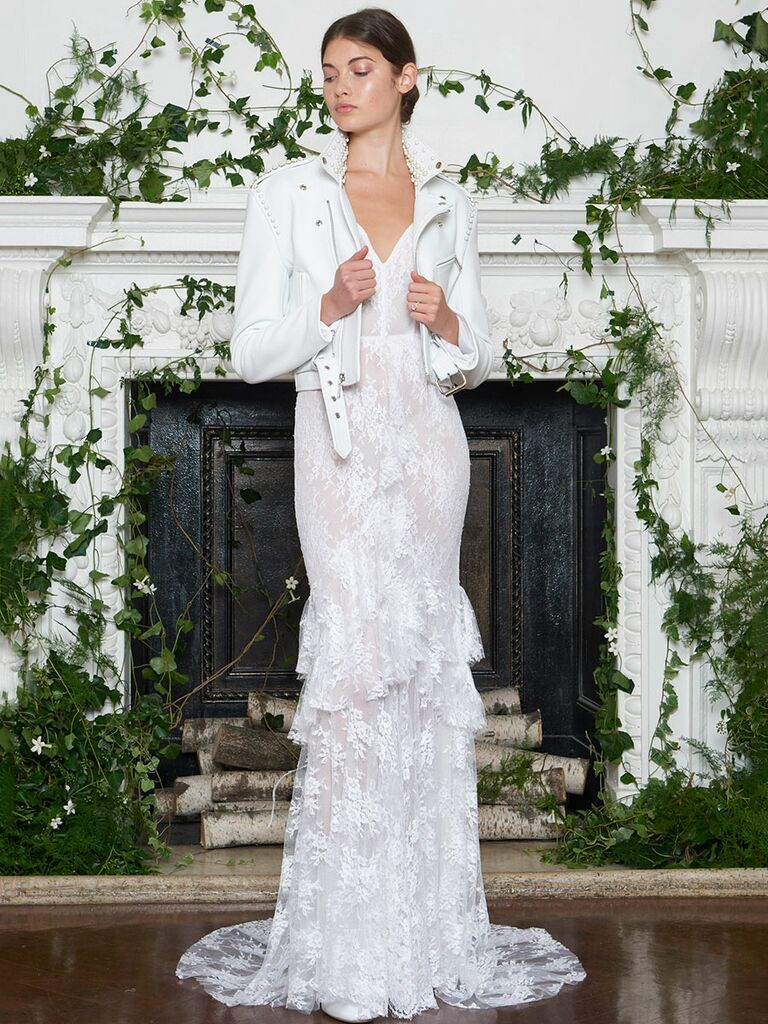 Monique Lhuillier Fall 2018 silk white leather motorcycle jacket over asymmetrical Chantilly lace sheath wedding dress