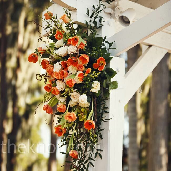 Downward floral swags decorated each side of the gazebo at the ceremony.