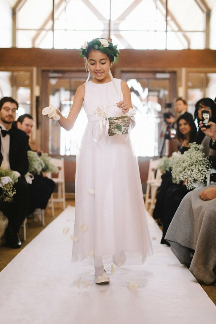 Josie's niece wore a crown of white roses and sprinkled white rose petals down the aisle.