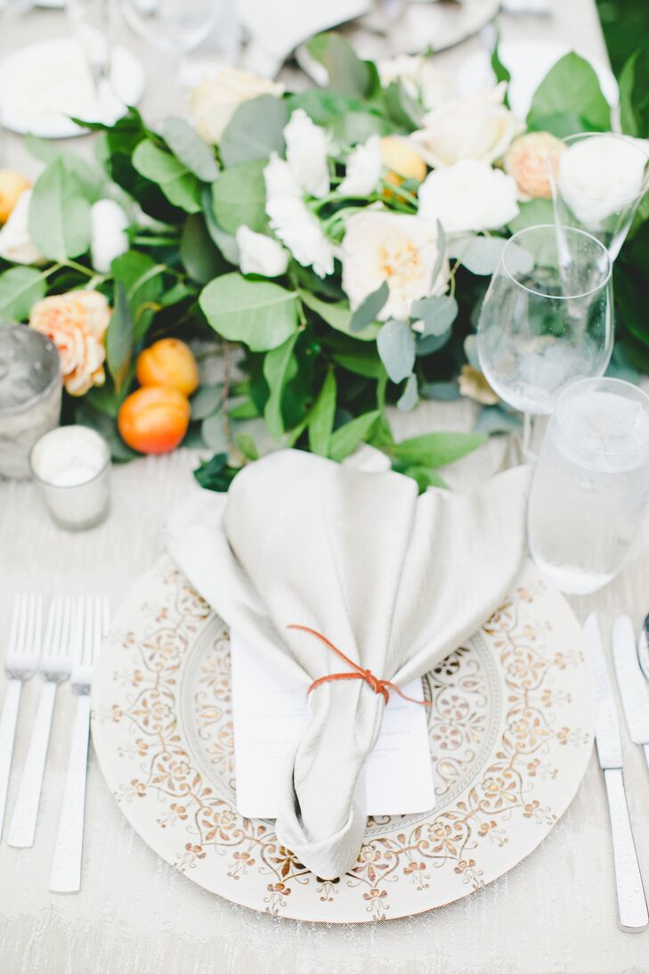 Lush greens and petite oranges served as centerpieces at the garden-inspired outdoor reception at Rancho Valencia in Rancho Santa Fe, California.