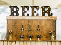 Rustic wood beer taps