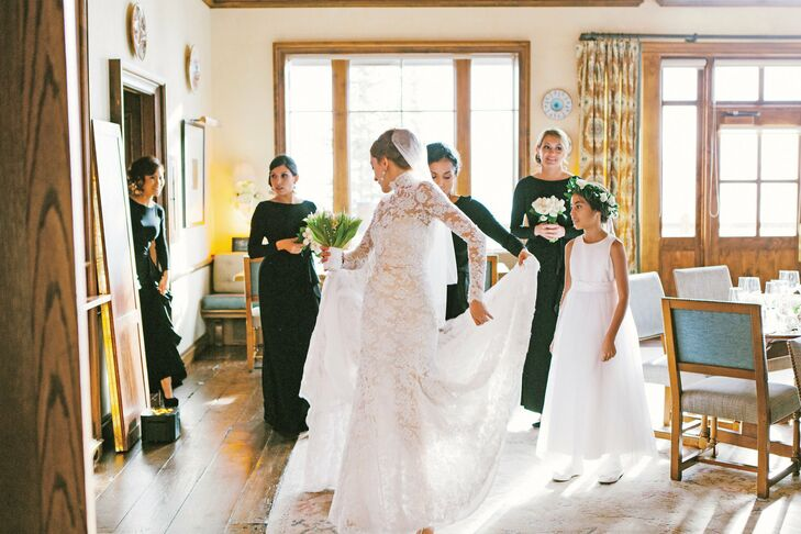 My checklist was unusual: I wanted lace, a high neck, long sleeves, and an open back, Josie says of her dream gown. Unable to find what she was looking for, she enlisted the help of a coworker to design it for her. There's nothing better than wearing a dress on your wedding day created specifically for you, she says.
