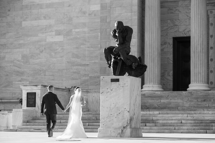 Bryan and Jackie parted from the ceremony toward the stairs leading into the museum, walked right past a beautiful statue perched on top of a stone pillar that reflected the building's gorgeous architecture.