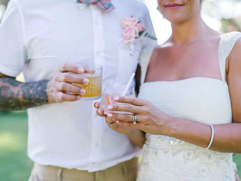 Bride and groom holding cocktails