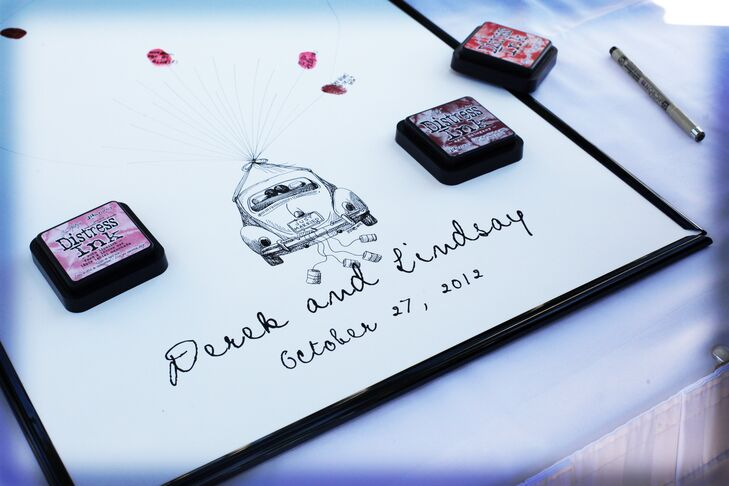 The couple had a framed wedding car guest book for family and friends to sign.