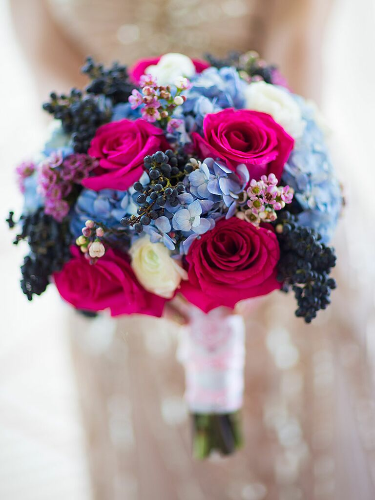 Blue and pink wedding bouquet with roses, hydrangea, wax flower, dark viburnum​ berries