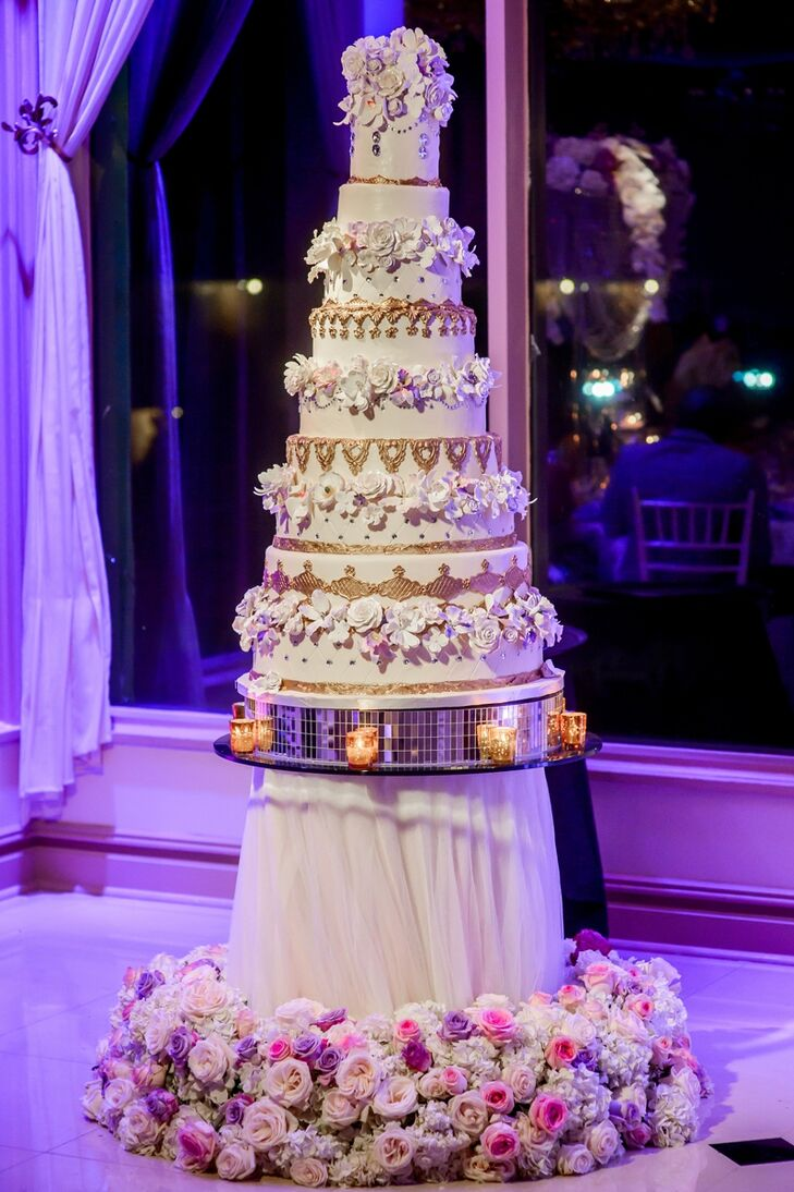 Nkenna dreamed of serving a statement cake, and Desserts by Dana didn't disappoint. She whipped up a nine-tier confection dressed to the nines with 3-D fondant flowers, gold foil, shimmery gems for an utterly eye-catching and undeniably decadent after-dinner treat.