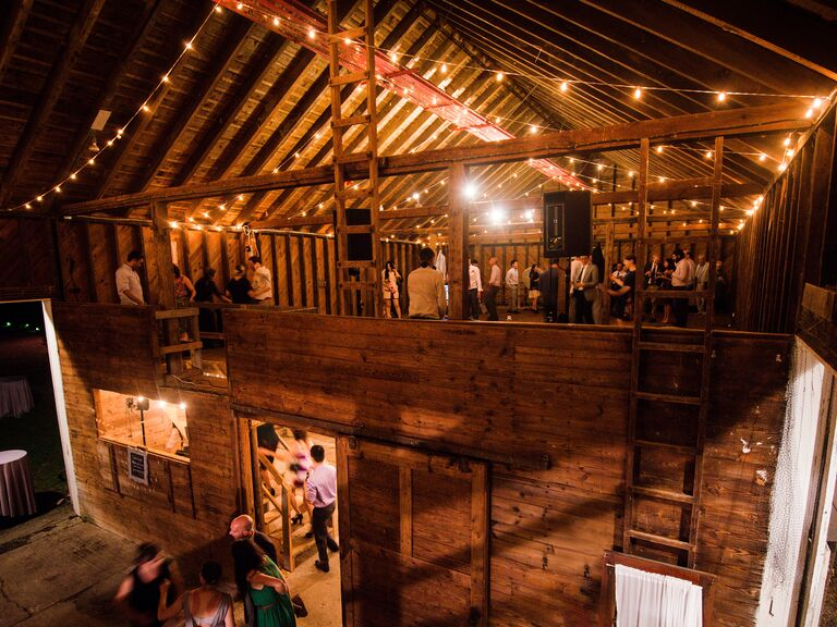 Guests dance during the reception at a barn wedding