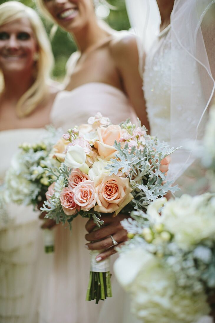 The bride carried pink, peach and white roses, stock, calla lilies and dusty miller.