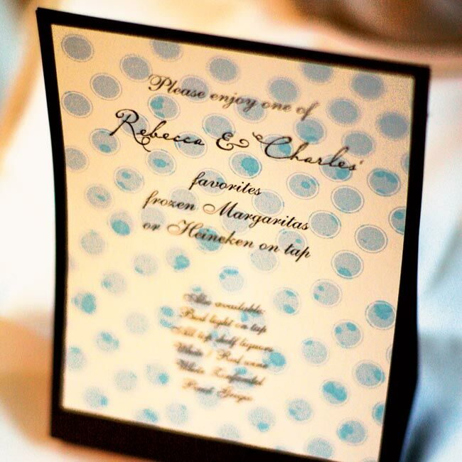 The classic white menu cards with brown font were given a fun, beachy touch with light blue ribbons.