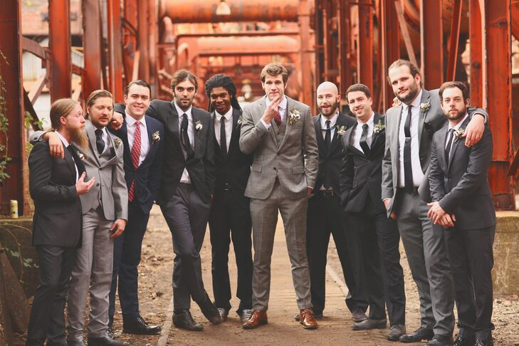 Peter's groomsmen wore their own suits—none matching—with white shirts and black ties.
