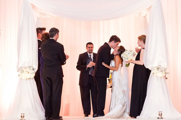 A color palette of white, cream, blush and silver enhanced the couple's theme of romantic elegance.