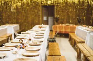 Sparkly Gold Reception with Rustic Wood Benches and Chargers