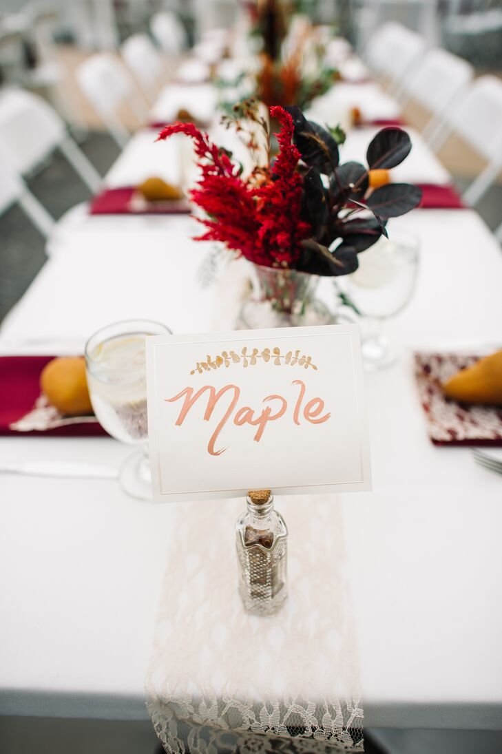 Their ivory table numbers also matched the day's natural decor. They fit the scenery with tree-inspired names, including aspen, oak, birch, pine, willow and spruce. Like the gold-leaf escort cards, Shelby also wrote out each table name by hand.