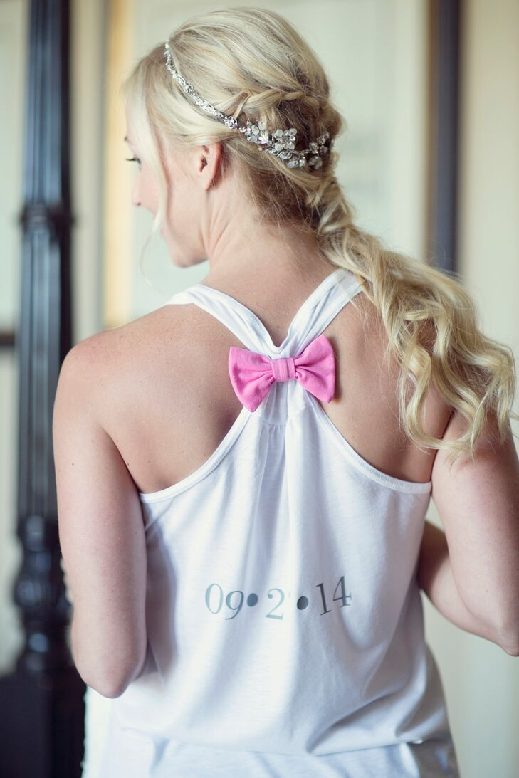 Bride's Curly Ponytail Hairstyle and Pink Bow Getting Ready Shirt