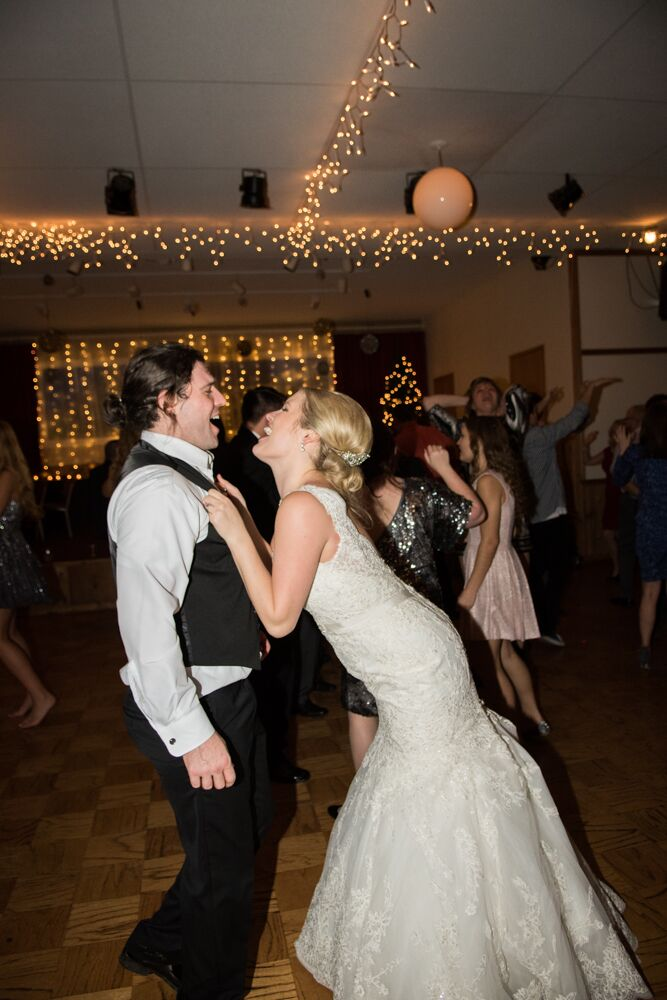 Blair and TJ danced the night away on the dance floor at their reception inside Swiss Sportmen's Club of Tacoma in Bonney Lake, Washington. Blair wore a V-neck ivory wedding dress accented with lace that flared out into a mermaid style skirt. TJ took off his black jacket for the reception and wore his black vest that went over his white collar dress shirt.