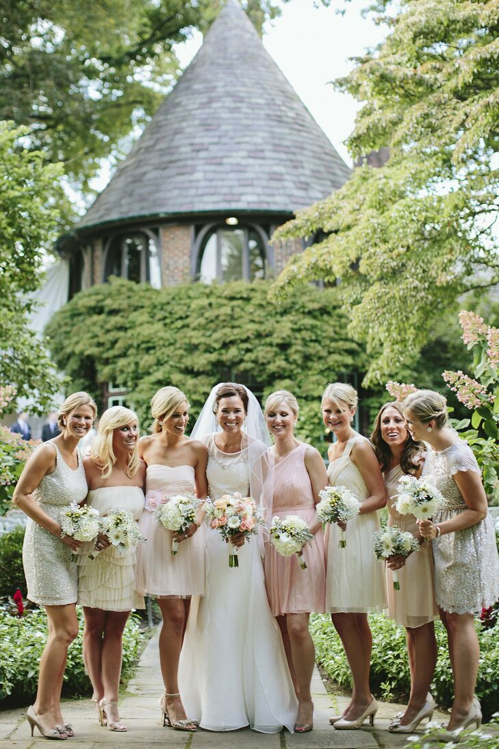 Amy let her seven bridesmaids choose their own dresses. I guided them on color and then let them do their own thing, she says. I loved how it turned out!