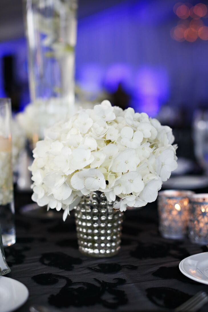 The bride added glam overtones to the reception by filling jeweled vases with clusters of hydrangeas.