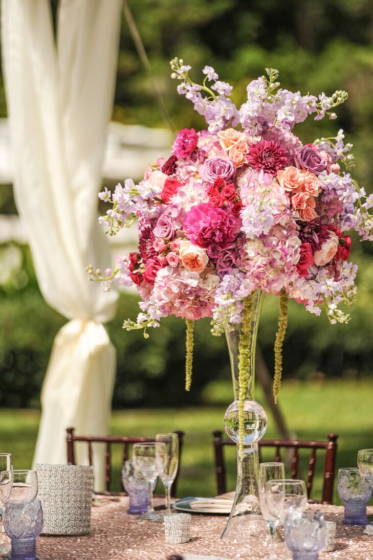 Each table was met with a lush arrangement of hydrangea, dahlias peonies, roses, garden roses and orchid in shades of lavender and pink.