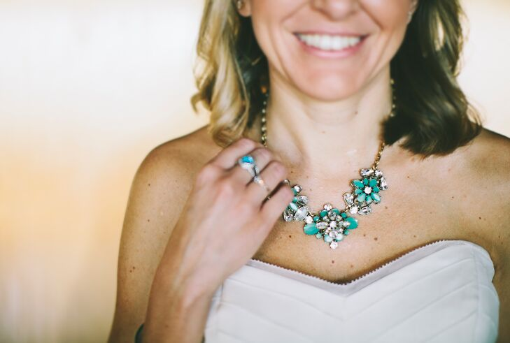 The bride paired a J.Crew necklace with her tea-length dress from BHLDN.