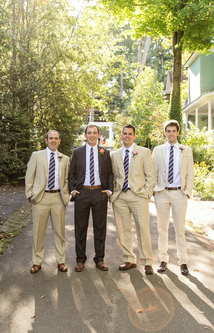 The groomsmen picked out various light tan suits to accent Jed's laid-back J.Crew look and donned matching navy and white striped ties.