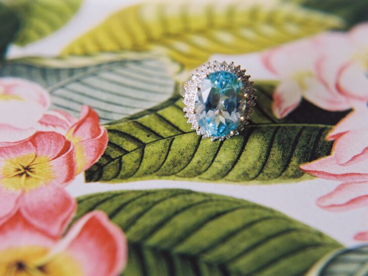"""Laura wore her grandmother's aquamarine engagement ring as her """"something blue"""" for the day."""