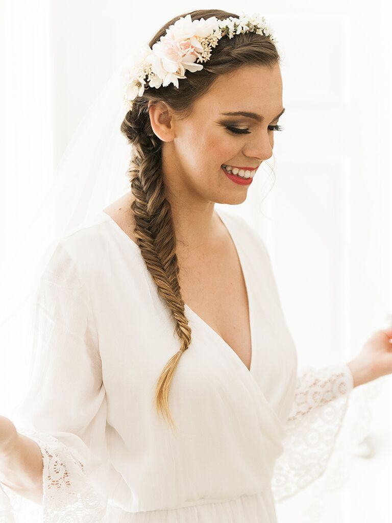 Fishtail braid wedding hairstyle with flowers