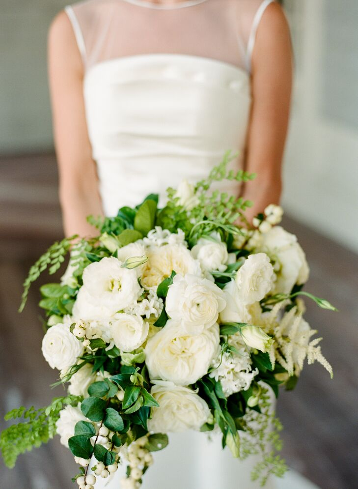 Caroline carried a bouquet of white hydrangeas, ranunculus and garden roses accented with an array of lush greenery.
