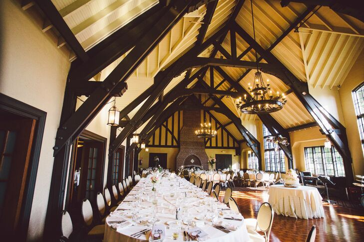 The reception was held in an elegant Tudor-style dining room with long banquet tables and ivory linens for a regal feel.