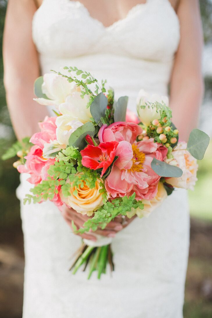 Tara's bouquet had a bright, textured look, filled with roses, tropical flowers, peonies, hypericum berries, eucalyptus and ferns.